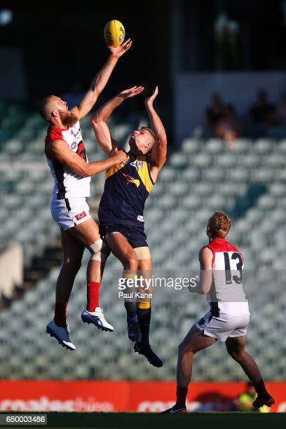 Max Gawn of the Demons wins the bounce against Nathan Vardy of the Eagles during the JLT Community Series AFL match between the West Coast Eagles and...