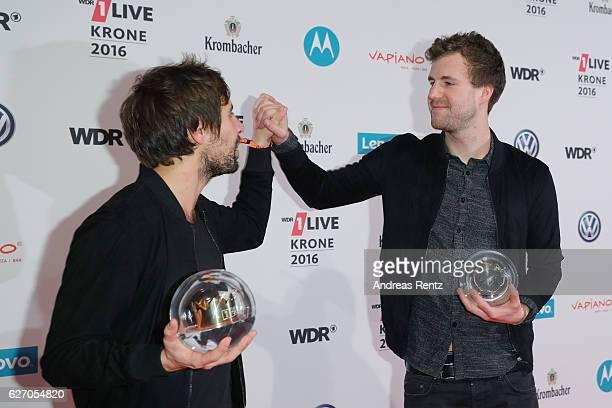 Max Giesinger and Luke Mockridge celebrate their award during the 1Live Krone at Jahrhunderthalle on December 1 2016 in Bochum Germany