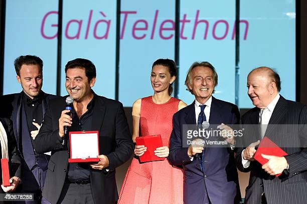 COVERAGE] Max Giusti Margareth Mad and Massimo Boldi are awarded by Luca Cordero di Montezemolo and Francesco Facchinetti on stage during the...