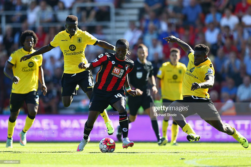 Max Gradel of Bournemouth is challenged by Micah Richards (R) and Idrissa Gueye (L) of Aston Villa during the Barclays Premier League match between Bournemouth and Aston Villa at the Vitality Stadium on August 8, 2015 in Bournemouth, England.