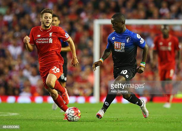 Max Gradel of Bournemouth is chased by Adam Lallana of Liverpool during the Barclays Premier League match between Liverpool and AFC Bournemouth at...
