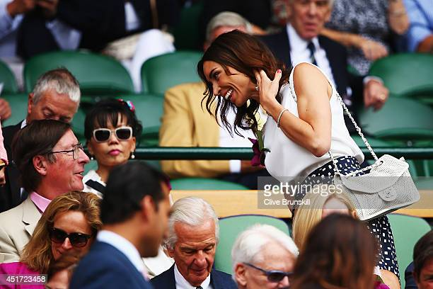 Max Hastings talks with Christine Bleakley as they sit in the Royal Box on Centre Court before the Ladies' Singles final match between Eugenie...