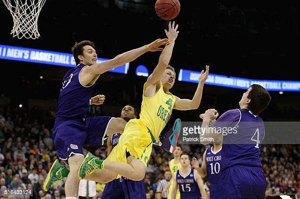 Max Heller of the Oregon Ducks attempts a shot against Derek Mountain of the Holy Cross Crusaders in the second half during the first round of the...