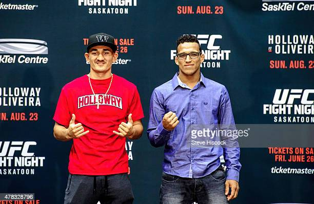 Max Holloway and Charles Oliveira square off for the crowd at a press conference at the SaskTel Centre June 24 2015 in Saskatoon Saskatchewan Canada