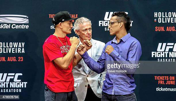 Max Holloway and Charles Oliveira square off in front of join Tom Wright UFC Executive VicePresident and General Manager for Canada Australia and New...