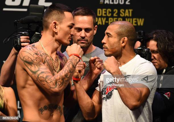Max Holloway and Jose Aldo of Brazil face off during the UFC 218 weighin inside Little Caesars Arena on December 1 2017 in Detroit Michigan