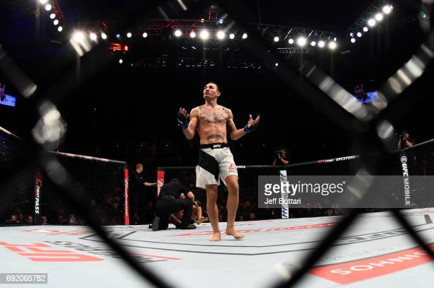 Max Holloway celebrates after his TKO victory over Jose Aldo of Brazil in their UFC featherweight championship bout during the UFC 212 event at...