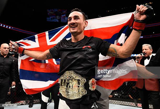 Max Holloway celebrates his TKO victory over Anthony Pettis in their interim UFC featherweight championship bout during the UFC 206 event inside the...