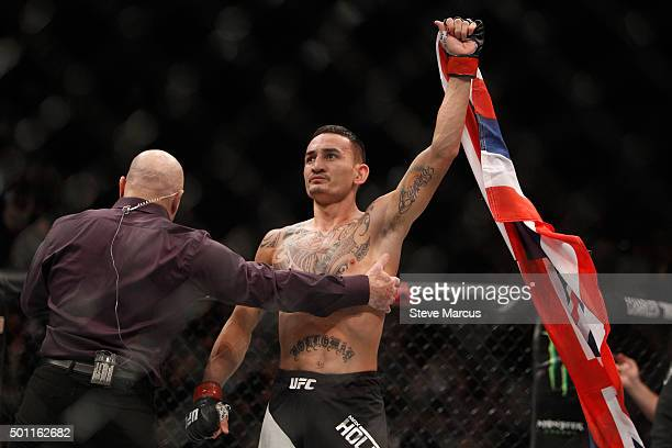 Max Holloway celebrates his victory over Jeremy Stephens in a featherweight fight during UFC 194 on December 12 2015 in Las Vegas Nevada