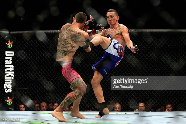 Max Holloway kicks Cub Swanson in their featherweight bout during the UFC Fight Night event at Prudential Center on April 18 2015 in Newark New Jersey