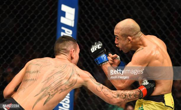 Max Holloway lands a body punch against Jose Aldo of Brazil in their UFC featherweight championship bout during the UFC 218 event inside Little...