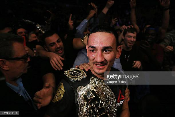 Max Holloway of the United States defeats Anthony Pettis of the United States for the Interim Featherweight Title during the UFC 206 event at Air...