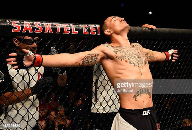 Max Holloway of the United States stands in the Octagon before his featherweight bout against Charles Oliveira during the UFC event at the SaskTel...