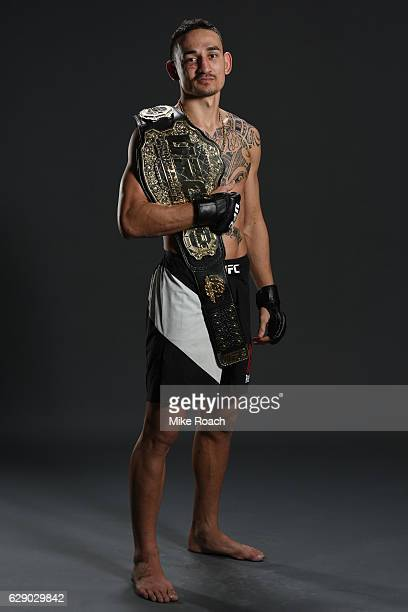 Max Holloway poses for a portrait backstage after his victory over Anthony Pettis during the UFC 206 event inside the Air Canada Centre on December...