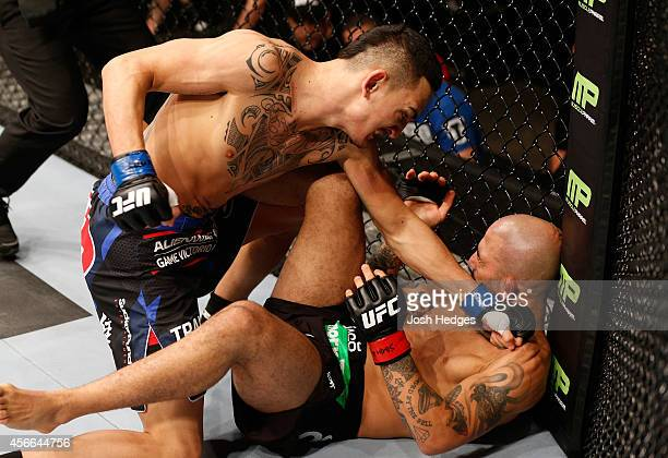 Max Holloway punches Akira Corassani of Sweden in their featherweight bout at the Ericsson Globe Arena on October 4 2014 in Stockholm Sweden