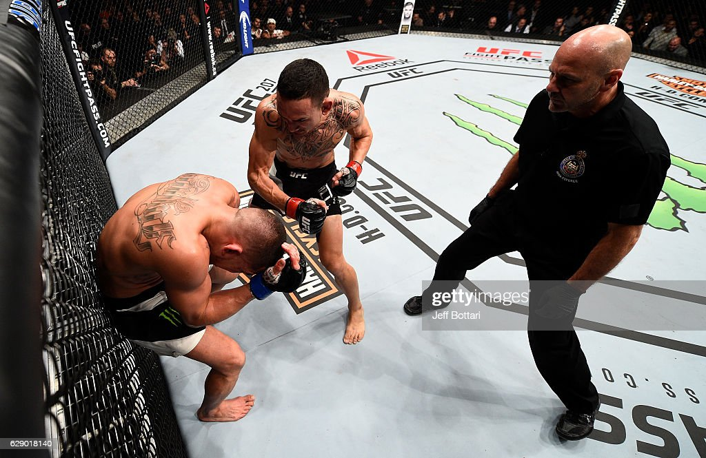 Max Holloway punches Anthony Pettis in their interim UFC featherweight championship bout during the UFC 206 event inside the Air Canada Centre on December 10, 2016 in Toronto, Ontario, Canada.