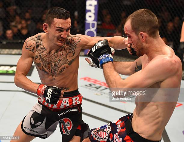 Max Holloway punches Cole Millerin their featherweight fight during the UFC Fight Night event inside 1stBank Center on February 14 2015 in Broomfield...