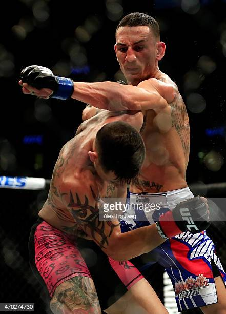 Max Holloway punches Cub Swanson in their featherweight bout during the UFC Fight Night event at Prudential Center on April 18 2015 in Newark New...