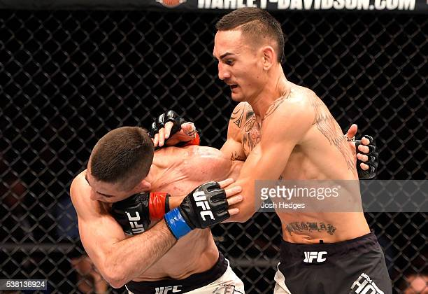 Max Holloway punches Ricardo Lamas in their featherweight bout during the UFC 199 event at The Forum on June 4 2016 in Inglewood California