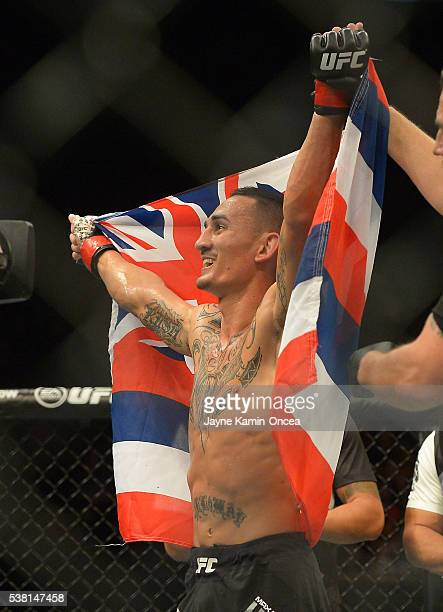 Max Holloway raises his arms after winning his featherweight bout at UFC 199 at The Forum on June 4 2016 in Inglewood California