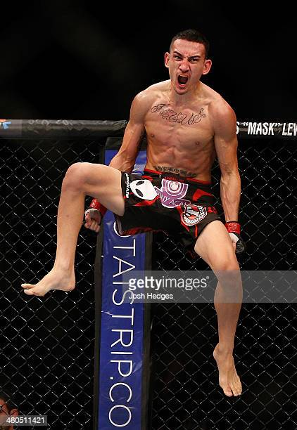 Max Holloway reacts after his TKO victory over Will Chope in their featherweight bout during the UFC Fight Night event at the Marina Bay Sands Resort...