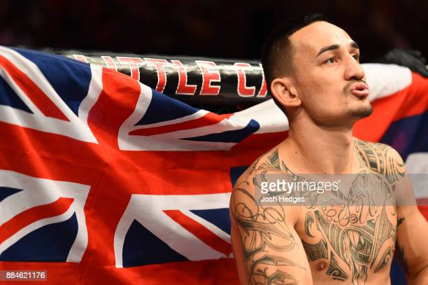 Max Holloway stands in his corner prior to facing Jose Aldo of Brazil in their UFC featherweight championship bout during the UFC 218 event inside...