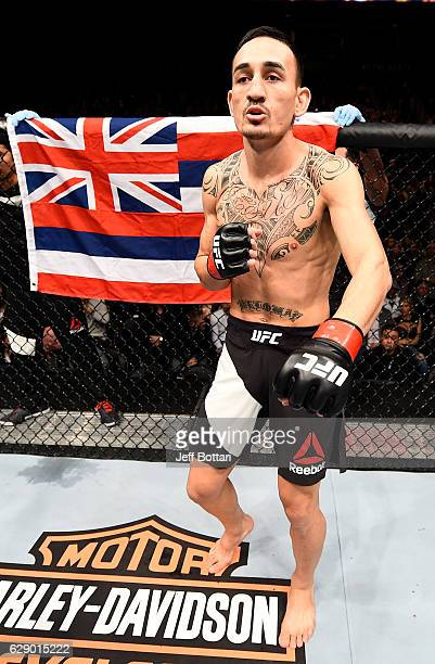 Max Holloway stands in the Octagon before his interim UFC featherweight championship bout against Anthony Pettis during the UFC 206 event inside the...