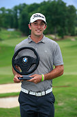 Max Homa holds the trophy after winning the BMW Charity ProAm Presented by SYNNEX Corporation held at the Thornblade Club on May 18 2014 in Greer...