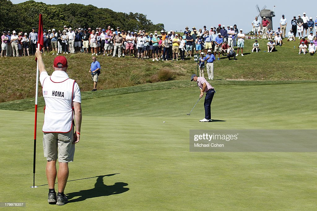 Max Homa of the United States team strokes a putt on the third green during the afternoon singles matches on Day One of the 2013 Walker Cup at National Golf Links of America on September 7, 2013 in Southampton, New York.