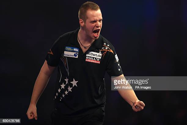 Max Hopp celebrates during his match against Vincent van der Voort during day eight of the William Hill World Darts Championship at Alexandra Palace...