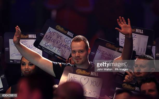 Max Hopp during his walk on during day eight of the William Hill World Darts Championship at Alexandra Palace London
