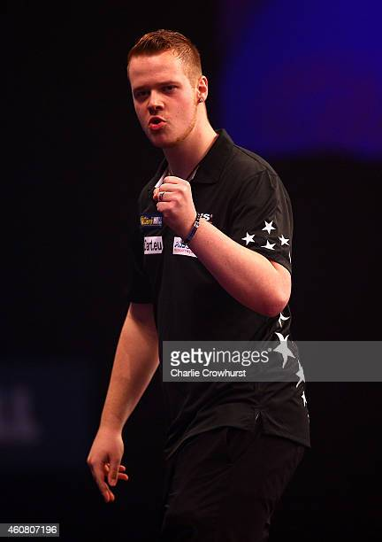 Max Hopp of Germany celebrates winning a leg during his first round match against Mervyn King of England during the William Hill PDC World Darts...