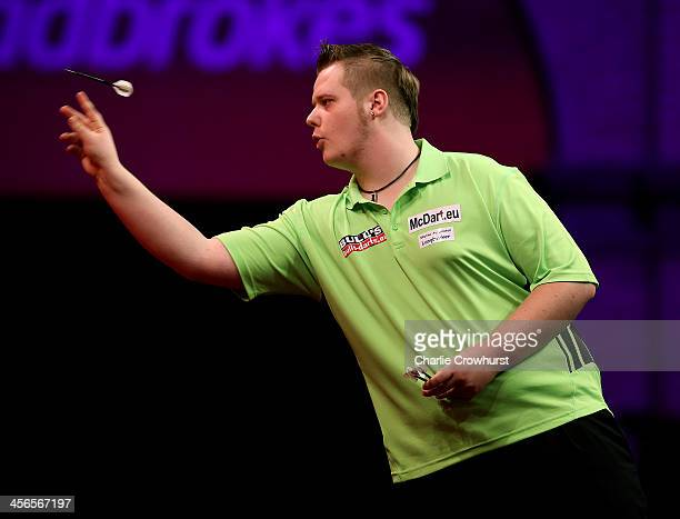 Max Hopp of Germany in action during his first round match against Robert Thornton of Scotland during the Ladbrokescom World Darts Championship on...