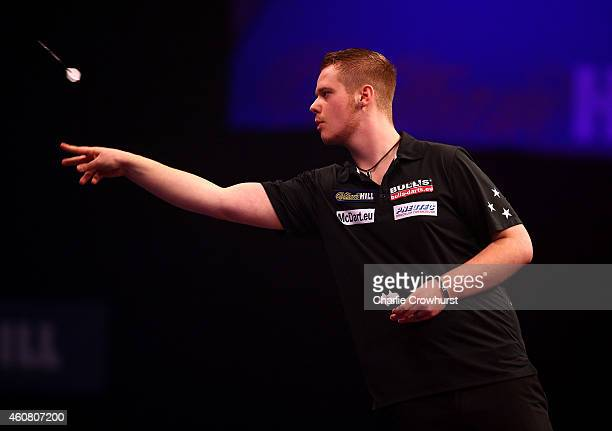 Max Hopp of Germany in action during his first round match against Mervyn King of England during the William Hill PDC World Darts Championships on...