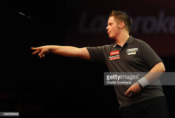 Max Hopp of Germany in action during his Preliminary round match on day two of the Ladbrokescom World Darts Championship at Alexandra Palace on...