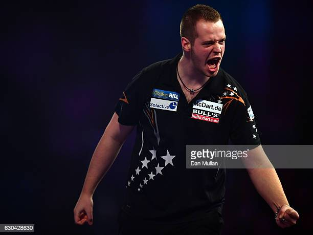 Max Hopp of Germany reacts during his first round match against Vincent van der Voort of the Netherlands on day eight of the 2017 William Hill PDC...