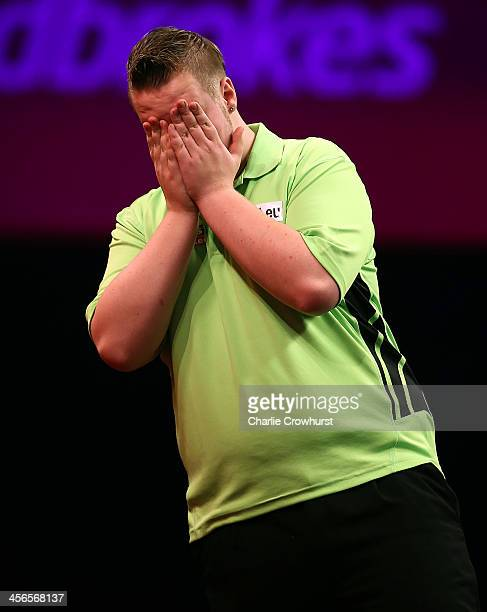 Max Hopp of Germany shows his dejection during his first round match against Robert Thornton of Scotland during the Ladbrokescom World Darts...