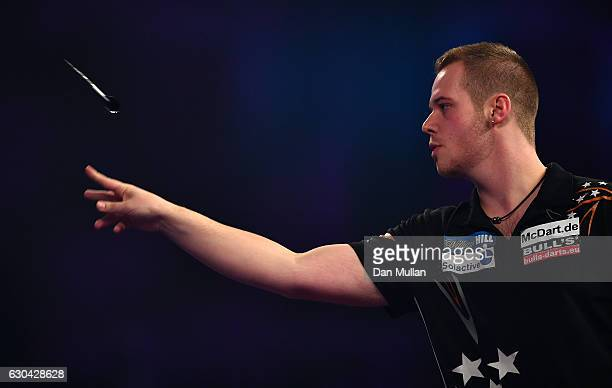 Max Hopp of Germany throws during his first round match against Vincent van der Voort of the Netherlands on day eight of the 2017 William Hill PDC...