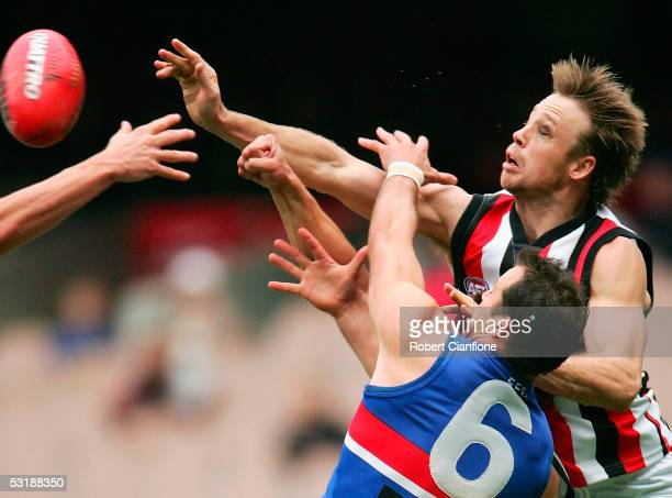 Max Hudghton of the Saints challenges Brad Johnson of the Bulldogs during the round 14 AFL match between the Western Bulldogs and St Kilda Saints at...