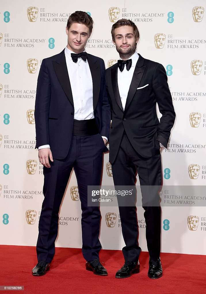 Max Irons and Douglas Booth pose in the winners room at the EE British Academy Film Awards at the Royal Opera House on February 14, 2016 in London, England.