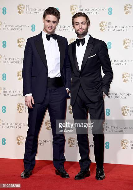 Max Irons and Douglas Booth pose in the winners room at the EE British Academy Film Awards at the Royal Opera House on February 14 2016 in London...