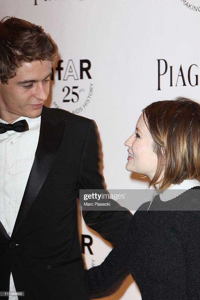 Max Irons and Emily Browning attend the amfAR Inspiration Gala photocall at Pavillon Gabriel on June 23, 2011 in Paris, France.