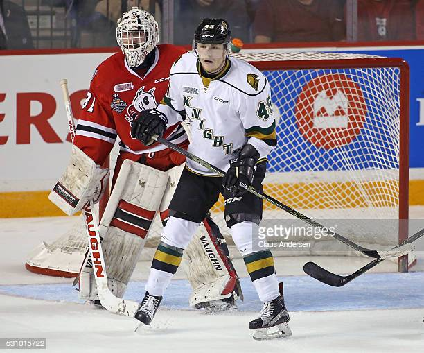 Max Jones of the London Knights waits for a shot to tip in front of Alex Nedeljkovic of the Niagara IceDogs during Game Four of the OHL Championship...
