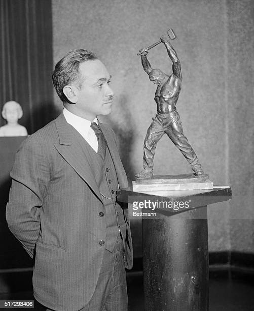 Max Kalish famous artist of Cleveland Ohio stands beside his statue 'Power' during the exhibit of his works in Grand Central Art Galleries in New...