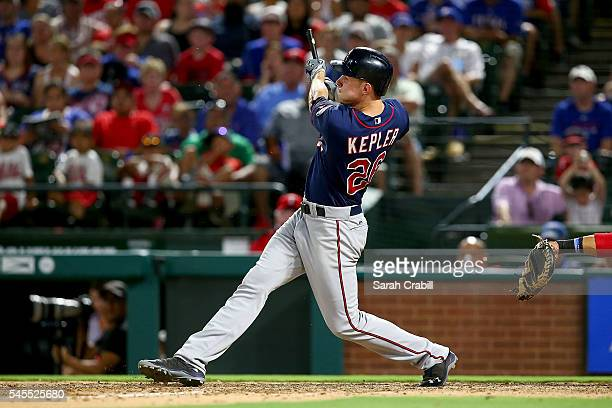 Max Kepler of the Minnesota Twins breaks his bat on a single in the sixth inning during a game against the Texas Rangers at Globe Life Park in...