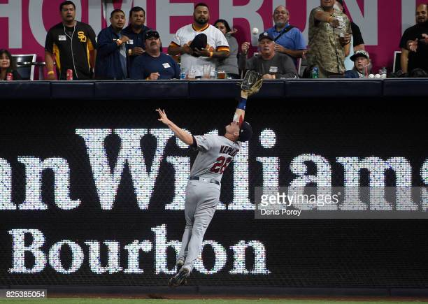 Max Kepler of the Minnesota Twins can't make the catch on a double hit by Austin Hedges of the San Diego Padres during the sixth inning of a baseball...