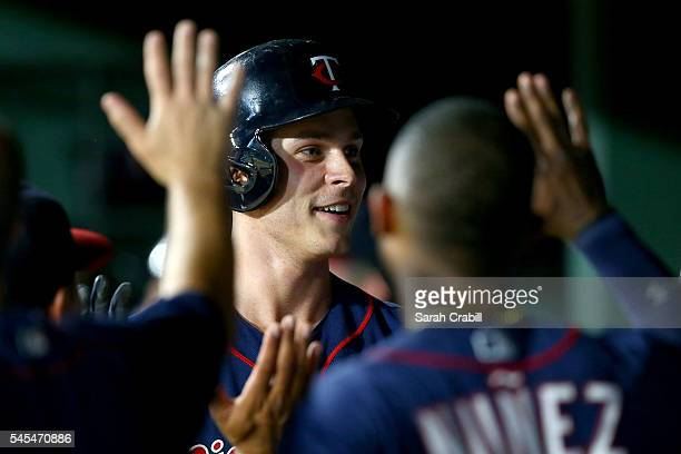 Max Kepler of the Minnesota Twins celebrates in the dugout after hitting a home run in the eighth inning during a game against the Texas Rangers at...