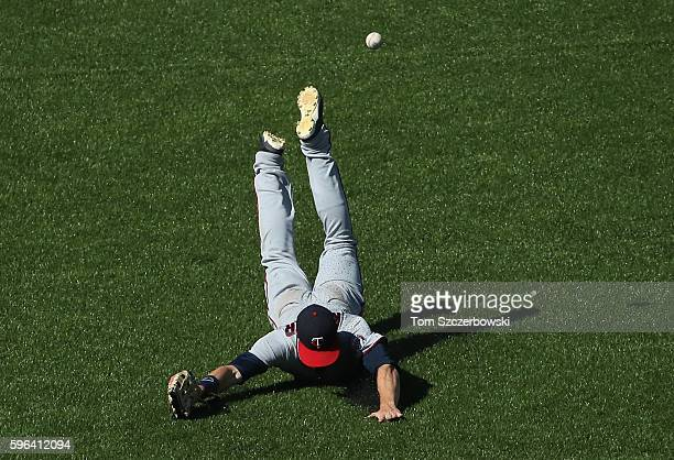 Max Kepler of the Minnesota Twins dives but cannot get to a ball hit by Melvin Upton Jr #7 of the Toronto Blue Jays that would end up being a tworun...