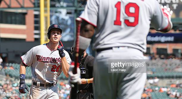 Max Kepler of the Minnesota Twins hits a solo home run in the ninth inning and celebrates with teammate Kennys Vargas during the game against the...