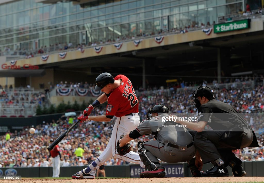 Max Kepler #26 of the Minnesota Twins hits a two-run double as Chris Iannetta #8 of the Arizona Diamondbacks catches during the first inning of the game on August 20, 2017 at Target Field in Minneapolis, Minnesota.